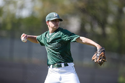 Maloney's Justin Kolesar throws out Wilcox Tech's Sean Dupuis at first Tuesday at Maloney High School in Meriden May 8, 2018 | Justin Weekes / Special to the Record-Journal