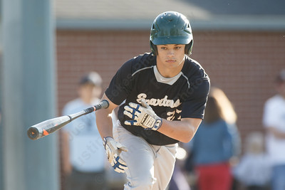 Maloney's Tanner Raymond takes first base Monday at Ceppa Field in Meriden May 21, 2018 | Justin Weekes / Special to the Record-Journal
