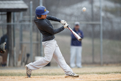 Maloney's Tanner Raymond makes contact Wednesday during a pre-season scrimmage at Pat Wall Field in Wallingford March 28, 2018 | Justin Weekes / Special to the Record-Journal