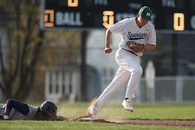 Maloney's Elliot Good tags out Platt's Ethan Dudley at second Wednesday at Ceppa Field in Meriden May 2, 2018 | Justin Weekes / Special to the Record-Journal