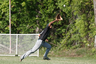 Maloney's Michael Valentin brings in a fly ball Monday at Ceppa Field in Meriden May 21, 2018 | Justin Weekes / Special to the Record-Journal