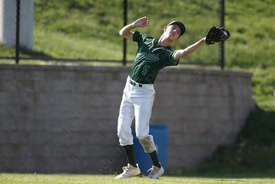 Maloney's Mike Duffy pulls in a fly ball Tuesday at Maloney High School in Meriden May 8, 2018 | Justin Weekes / Special to the Record-Journal