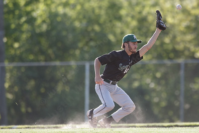 Maloney's Spencer Santagata just misses a hopper Monday at Ceppa Field in Meriden May 21, 2018 | Justin Weekes / Special to the Record-Journal