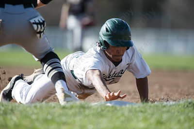 Maloney's Michael Valentin dives back to first base Thursday at Ceppa Field in Meriden April 26, 2018 | Justin Weekes / Special to the Record-Journal