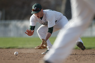 Maloney's Joseph Golebiewski fields a hit Wednesday at Ceppa Field in Meriden May 2, 2018 | Justin Weekes / Special to the Record-Journal