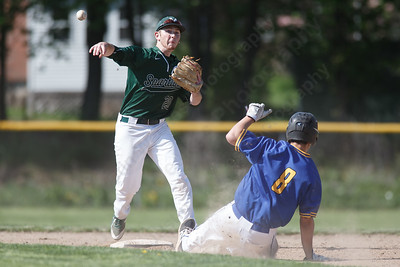 Maloney's Joseph Golebiewski turns the double play Tuesday at Maloney High School in Meriden May 8, 2018 | Justin Weekes / Special to the Record-Journal
