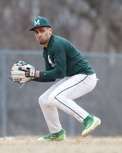 Maloney's Christopher Infante field a ground ball Wednesday during a pre-season scrimmage at Pat Wall Field in Wallingford March 28, 2018 | Justin Weekes / Special to the Record-Journal