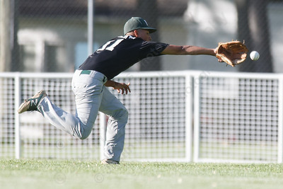 Maloney's Michael Valentin tries to reach a fly ball Monday at Ceppa Field in Meriden May 21, 2018 | Justin Weekes / Special to the Record-Journal