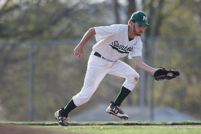 Maloney's Spencer Santagata fields a hit Wednesday at Ceppa Field in Meriden May 2, 2018 | Justin Weekes / Special to the Record-Journal