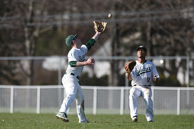 Maloney's Joseph Golebiewski and  Michael Valentin come together on a fly ball Thursday at Ceppa Field in Meriden April 26, 2018 | Justin Weekes / Special to the Record-Journal