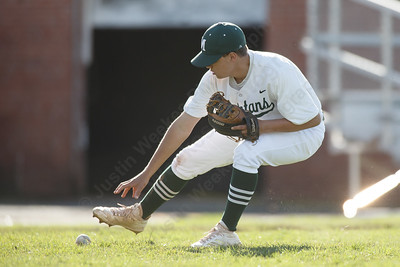 Maloney's Justin Kolesar fields a bunt Thursday at Ceppa Field in Meriden April 26, 2018 | Justin Weekes / Special to the Record-Journal