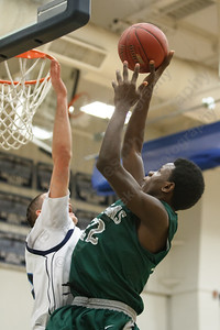 Maloney's Mehkl Warren (22) puts up a shot over Middletown's Chris Rodo (15) Thursday at Middletown High School in Middletown Feb. 5, 2015 | Justin Weekes / For the Record-Journal