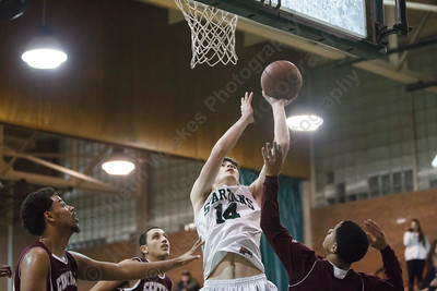 Maloney's Ethan Haxhaj  (14) puts up a shot for two in the lane Tuesday at Maloney High School in Meriden Feb. 17, 2015 | Justin Weekes / For the Record-Journal
