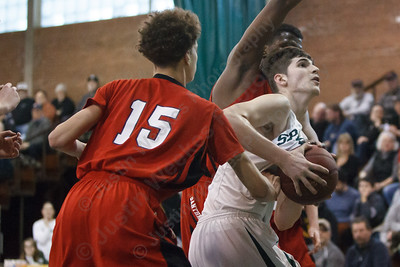 Maloney's Ethan Haxhaj (14) wrestles for a rebound with E.O. Smith's Fenton Bradley (15) and Rahim Mama (10) Tuesday at Maloney High School in Meriden  Mar. 10, 2015 | Justin Weekes / For the Record-Journal