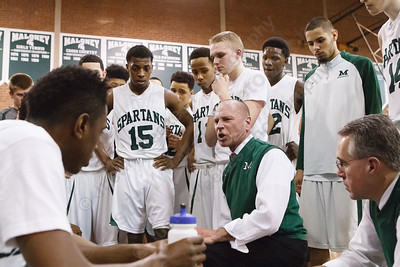 Maloney's coach Howard Hewitt goes over a play during a time out in the fourth quarter Tuesday at Maloney High School in Meriden  Mar. 10, 2015 | Justin Weekes / For the Record-Journal