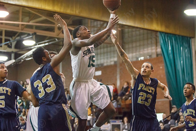 Maloney's Jamel Hamans (15) splits Platt's defense for two Monday at Maloney High School in Meriden Feb. 23, 2015 | Justin Weekes / For the Record-Journal