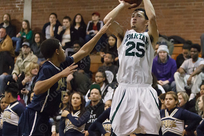 Maloney's Cameron Quinones (25) lines up a three point shot as Platt's Rickie Sanders (5) tries to block Monday at Maloney High School in Meriden Feb. 23, 2015 | Justin Weekes / For the Record-Journal