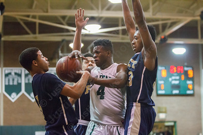 Platt's defense surrounds Maloney's Jaron Cogdell (4) Monday at Maloney High School in Meriden Feb. 23, 2015 | Justin Weekes / For the Record-Journal