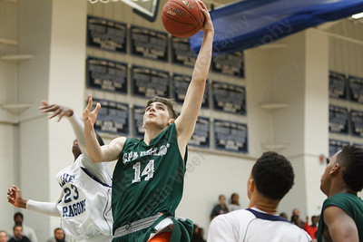 Maloney's Ethan Haxhaj (14) drives t the basket past Middletown's Ahmod Privott (23) Thursday at Middletown High School in Middletown Feb. 5, 2015 | Justin Weekes / For the Record-Journal