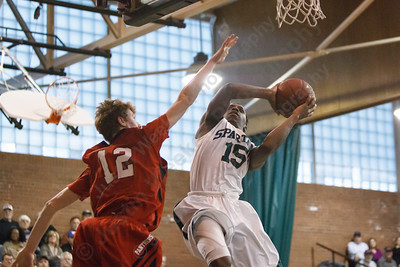 Maloney's Jamel Hamans (15) drives to the basket as E.O. Smith's Connor Knecht (12) defends Tuesday at Maloney High School in Meriden  Mar. 10, 2015 | Justin Weekes / For the Record-Journal