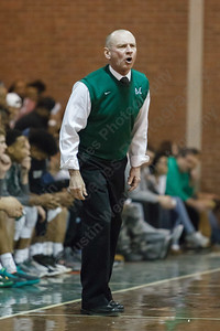 Maloney's coach Howard Hewitt calls in a play Monday at Maloney High School in Meriden Feb. 23, 2015 | Justin Weekes / For the Record-Journal