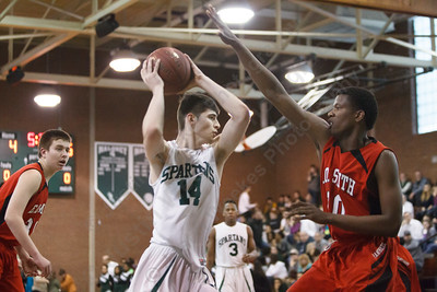 Maloney's Ethan Haxhaj (14) works the low post on E.O. Smith's Rahim Mama  (10) Tuesday at Maloney High School in Meriden  Mar. 10, 2015 | Justin Weekes / For the Record-Journal