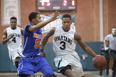Maloney's Tracy Rumley (3) drives past Bloomfield's Jordon Pruitt (5) Friday at Maloney High School in Meriden Jan 2, 2015 | Justin Weekes / For the Record-Journal