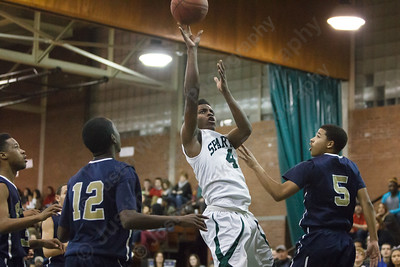 Maloney's Jaron Cogdell (4) pulls up in the lane for two Monday at Maloney High School in Meriden Feb. 23, 2015 | Justin Weekes / For the Record-Journal