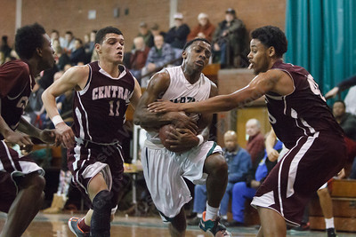 Maloney's Jamel Hamans (15) gets fouled by Bristol Central's Landin Rutledge (40) Tuesday at Maloney High School in Meriden Feb. 17, 2015 | Justin Weekes / For the Record-Journal