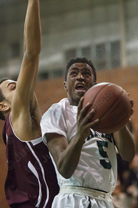 Maloney's Jordan Martin (5) goes in strong on Bristol Central's Jamill Tolliver  (34) Tuesday at Maloney High School in Meriden Feb. 17, 2015 | Justin Weekes / For the Record-Journal