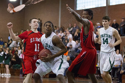 Maloney's Jamel Hamans (15) drives to the basket between E.O. Smith's Brad Walden (11) and Rahim Mama  (10) Tuesday at Maloney High School in Meriden  Mar. 10, 2015 | Justin Weekes / For the Record-Journal