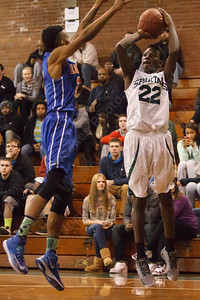 Maloney's Mehki Warren (22) shoots over Bloomfield's Marquise Brown (2) Friday at Maloney High School in Meriden Jan 2, 2015 | Justin Weekes / For the Record-Journal