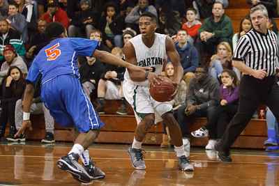 Maloney's Tracy Rumley (3) pulls up for a jumper as Bloomfield's Jordon Pruitt (5) defends Friday at Maloney High School in Meriden Jan 2, 2015 | Justin Weekes / For the Record-Journal