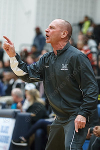 Maloney's head coach Howard Hewitt voices his displeasure to the referee on a bad call Thursday at Middletown High School in Middletown Feb. 5, 2015 | Justin Weekes / For the Record-Journal