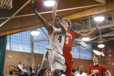 Maloney's Jaron Cogdell (4) puts in a layup beating E.O. Smith's Fenton Bradley (15) Tuesday at Maloney High School in Meriden  Mar. 10, 2015 | Justin Weekes / For the Record-Journal