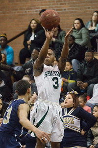 Maloney's Tracy Rumley (3) puts up a three point attempt over Platt's Louis Torres (23) Monday at Maloney High School in Meriden Feb. 23, 2015 | Justin Weekes / For the Record-Journal