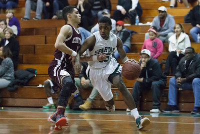 Maloney's Jamel Hamans (15) looks for room on the baseline as Bristol Central's Eddie Rodriguez Salas (11) guards Tuesday at Maloney High School in Meriden Feb. 17, 2015 | Justin Weekes / For the Record-Journal