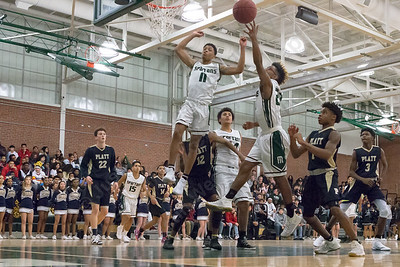 Maloney's Romello Samuels (11) and Divine Ransom (20) reach for a rebound Friday at Maloney High School in Meriden January 19, 2018 | Justin Weekes / Special to the Record-Journal