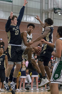 Maloney's Damien Pantoja gets fouled by Platt's Carson Coon Friday at Maloney High School in Meriden January 19, 2018 | Justin Weekes / Special to the Record-Journal