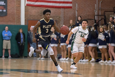 Platt's Malcolm Andrews pushes up court on a fast break Friday at Maloney High School in Meriden January 19, 2018 | Justin Weekes / Special to the Record-Journal