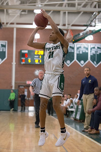 Maloney's Romello Samuels hits a three point shot Friday at Maloney High School in Meriden January 19, 2018 | Justin Weekes / Special to the Record-Journal