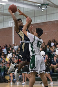 Platt's Tremayne Carter drives on Maloney's Yadiel Ocasio Friday at Maloney High School in Meriden January 19, 2018 | Justin Weekes / Special to the Record-Journal