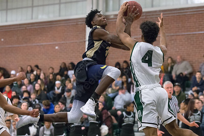 Platt's Malcolm Andrews  gets fouled by Maloney's Damien Pantoja Friday at Maloney High School in Meriden January 19, 2018 | Justin Weekes / Special to the Record-Journal