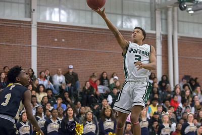 Maloney's Kamil Henderson puts in a layup Friday at Maloney High School in Meriden January 19, 2018 | Justin Weekes / Special to the Record-Journal