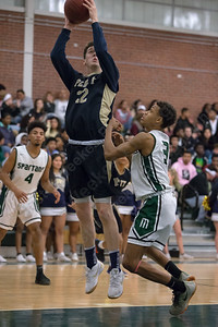 Platt's Carson Coon puts in a layup Friday at Maloney High School in Meriden January 19, 2018 | Justin Weekes / Special to the Record-Journal
