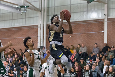 Platt's Malcolm Andrews  puts in a layup Friday at Maloney High School in Meriden January 19, 2018 | Justin Weekes / Special to the Record-Journal
