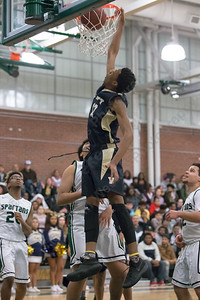 Platt's Justin Radford throws down for two Friday at Maloney High School in Meriden January 19, 2018 | Justin Weekes / Special to the Record-Journal