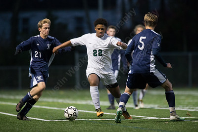 Maloney's Kamar Mullings works past Wilton defenders Wednesday during the quarter final round of the CIAC Class L tournament at Falcon Field in Meriden  November 8, 2017 | Justin Weekes / For the Record-Journal