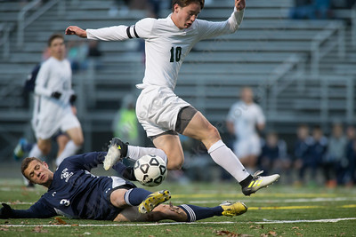 Maloney's Bryan Brazel gets tackled by Wilton's John Zizzadoro Wednesday during the quarter final round of the CIAC Class L tournament at Falcon Field in Meriden  November 8, 2017 | Justin Weekes / For the Record-Journal