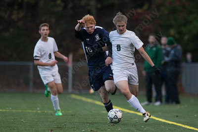 Maloney's Flint Rich works past Witon's Colin Kroll Wednesday during the quarter final round of the CIAC Class L tournament at Falcon Field in Meriden  November 8, 2017 | Justin Weekes / For the Record-Journal